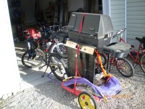 Towing a bbq by bike Image