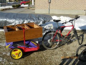 Hauling bookshelves by bike image